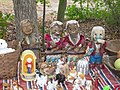Figurines and other items on a vendor's blanket, Cameron Antiques Fair.jpg