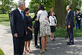 First lady Michelle Obama, center foreground, greets Chairman of the Joint Chiefs of Staff U.S. Army Gen. Martin E. Dempsey at Arlington National Cemetery in Arlington, Va., May 27, 2013 130527-A-VS818-072.jpg