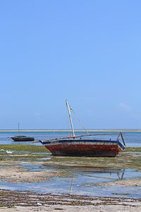 Fishing boats as viewed from Nyali Beach next to the Reef Hotel during low tide and still conditions in Mombasa, Kenya 2.jpg
