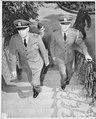 Fleet Admiral Ernest J. King (left), accompanied by Commander R. E. Dornin, mount the steps to their quarters near... - NARA - 198827.tif