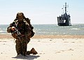 Flickr - Official U.S. Navy Imagery - A Marine holds position on a beach with the Polish navy transport mine-layer OPR Krakow in the background during a Baltic Operations 2012 amphibious operation exercise..jpg