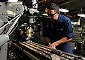 Flickr - Official U.S. Navy Imagery - Sailor shapes a valve in the USS Abraham Lincoln machine shop..jpg