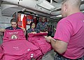 Flickr - Official U.S. Navy Imagery - Sailors sell pink T-shirts at sea..jpg