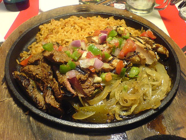 Chicken and beef fajita, a popular example of Tex-Mex cuisine. Photo ...