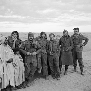 1st Marine Infantry Parachute Regiment - Members of the French Squadron SAS (1st Parachute Chasseur Company,1ere Compagnie de Chasseurs Parachutistes,1eCCP) during the link-up between advanced units of the 1st and 8th armies in the Gabes-Tozeur area of Tunisia. Previously a company of Free French paratroopers, the French SAS were the first of a range of units 'acquired' by Major Stirling as the SAS expanded.