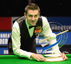Selby with 2015 German Masters trophy German Masters 2015 champion Mark Selby with trophy (Martin Rulsch).jpg