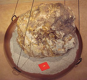 Gold - Relative sizes of an 860 kg block of gold ore, and the 30 g of gold that can be extracted from it. Toi gold mine, Japan.