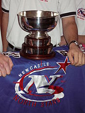 The Goodall Cup resting on a Newcastle North Stars jersey in 2004 prior to the AIHL & Goodall Cup finals in September 2004.