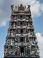 Gopuram monumental ornate tower at the entrance of Sri Mariamman Temple with sculptures of Hindu deities Chinatown Singapore.jpg