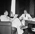 Gouverneur Klaasesz (rechts) in gesprek met een ambtenaar bij de voorbereiding v, Bestanddeelnr 252-2502.jpg