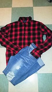 Grunge fashion fashion trend characterized by loose, layered, worn clothing, especially flannel shirts, ripped jeans, and chunky boots