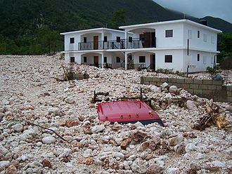 Hurricane Gustav - A truck buried under rubble in Haiti