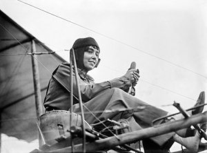 Aviator Hélène Dutrieu seated in her airplane