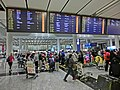 HK Airport Arrival area zone interior luggage belt information display monitors n visitors Feb-2013.JPG