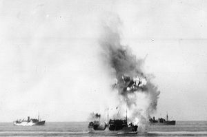 SS Ohio - A torpedo from Axum, an Italian submarine, strikes the tanker on her port side.