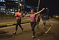 Happy people doing exercises at night on the streets of kigali.jpg