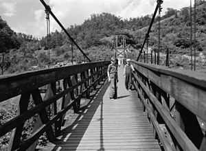 Hazard, Kentucky - Coal miners' children cross a footbridge into Hazard, Kentucky, July 1940.  Photograph by Marion Post Wolcott.