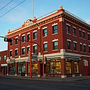 Brick commercial buildings along 97 Street.