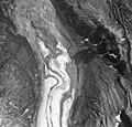 Iliamna Glacier, terminus of valley glacier turning into a rock glacier, and trimline along valley walls, August 25, 1964 (GLACIERS 6579).jpg