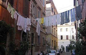 English: Laundry is hung to dry above an Itali...