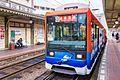 Iyotetsu 2100 series tram 2104 at Dogo Onsen Station 2017-04-05 (34485081595).jpg