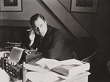 J B Priestley at work in his study, 1940. (7893553148).jpg