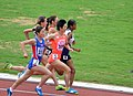 Japan's Ayako Jinnouchi (3) Sprints Through The middle To Win The Women's 1500m First Round Race From India's Chitra P U (4) And North Korea's Hyo Sim.jpg