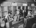Jerome Relocation Center, Denson, Arkansas. A crew of postal workers engaged in sorting packages at . . . - NARA - 538850.tif