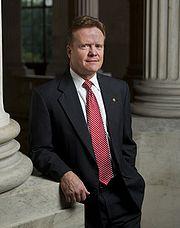 Jim Webb, leaning against pillar, 2007.jpg