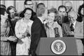 Jimmy Carter kisses Rosalynn Carter during ceremony in which he receives the Final Report of the President's... - NARA - 179117.tif