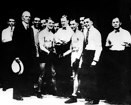Freddie Welsh vs Benny Leonard, May 28, 1917 world championship, boxers shaking hands in front of a crowd of men
