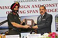 Jitendra Singh being presented a memento by the Director General Border Roads, Lt. Gen. Harpal Singh, at the International Seminar on 'Planning.JPG