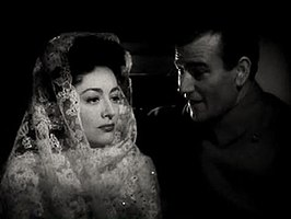 Joan Crawford en John Wayne in Reunion in France