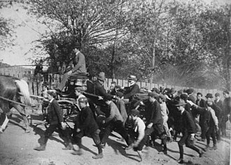 Coal strike of 1902 - John Mitchell, President of the UMWA, arriving in Shenandoah surrounded by a crowd of breaker boys.