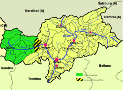 Vinschgau district (highlighted in green) within South Tyrol; the yellow-black stripes mark the geographical extent of the valley