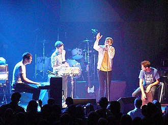 Keane (band) - Keane performing live in Washington, D.C. in 2009. From left to right: Tim Rice-Oxley, Jesse Quin, Tom Chaplin, Richard Hughes