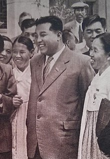 Kim il sung conversing with female representatives cropped.jpg
