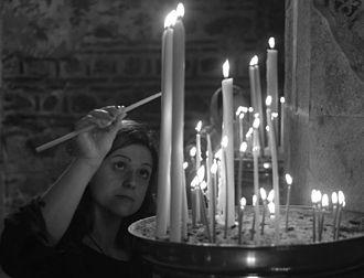 Candle - Candle lighting in the Visoki Dečani monastery