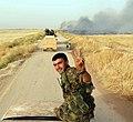 Kurdish YPG Fighter (18529088401).jpg