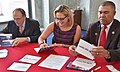 Kyrsten Sinema signing holiday cards for troops in 2016. 02.jpg