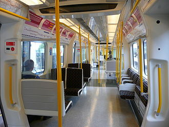 London Underground S7 and S8 Stock - The interior of a London Underground Metropolitan line S8 Stock train with transverse seats.