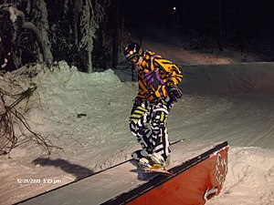 Snowboard - A snowboarder practicing jibbing