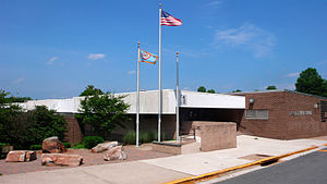 Langley, Virginia - Langley High School, pictured here in June 2008, serves much of northeastern Fairfax County, Virginia. Visible on the left is the five stone memorial to the families affected by the September 11 attack on the Pentagon, the headquarters of the U.S. Department of Defense.