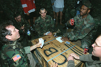 Larry Gatlin - Gatlin (left) playing cards with Seabees in Croatia after a performance in 1995