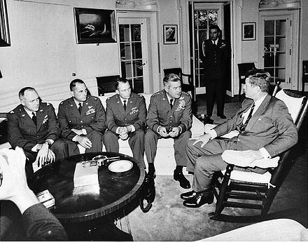 President Kennedy meets in the Oval Office with General Curtis LeMay and the reconnaissance pilots who found the missile sites in Cuba. LeMay Cuban Missile Crisis.jpg