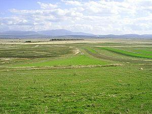 Polje - Livanjsko Polje in Bosnia is the largest polje in the world (Mount Dinara visible in the background).