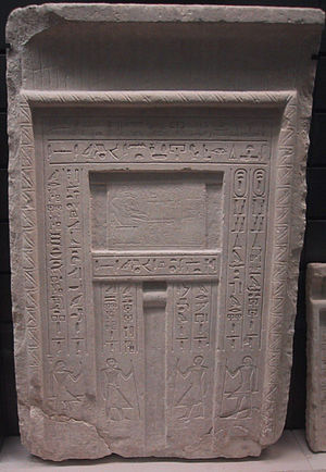 False door - A typical false door to an Egyptian tomb - the deceased is shown above the central niche in front of a table of offerings, and inscriptions listing offerings for the deceased are carved along the side panels.