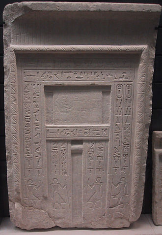 False door - A typical false door to an Egyptian tomb. The deceased is shown above the central niche in front of a table of offerings, and inscriptions listing offerings for the deceased are carved along the side panels.