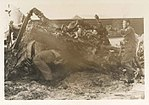 MAG-11 Marines remove debris following a Viet Cong rocket attack on Da Nang Air Base.jpg