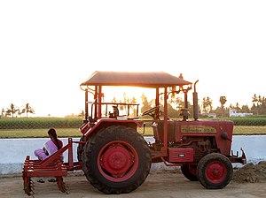 Mahindra Tractors - Mahindra 575 Di at sunset over a sugar cane field, Tamil Nadu, India